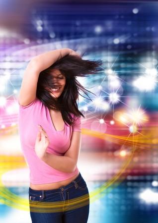 young woman dancing in a disco photo