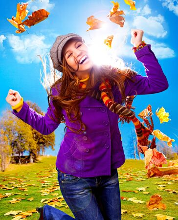young happy woman with foliage in autumn Stock Photo - 7588288