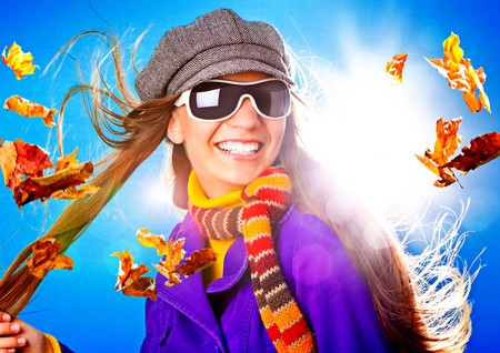 portrait of young happy woman with foliage in autumn Stock Photo - 7588282