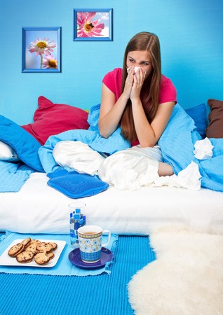 young woman is sick and suffers in her bed photo