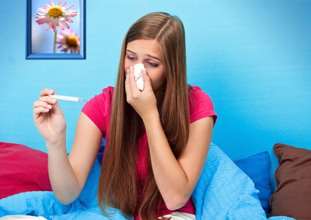young woman is sick and suffers in her bed Standard-Bild