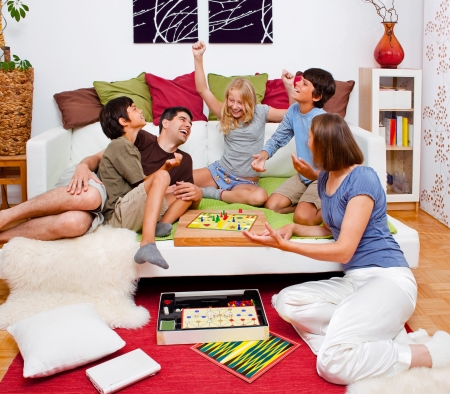 family fight: a young family is playing board-games in their bed