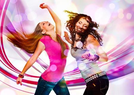 dancing disco: two young girls dancing in discolight