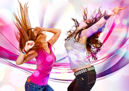 laser lights: two young girls dancing in discolight