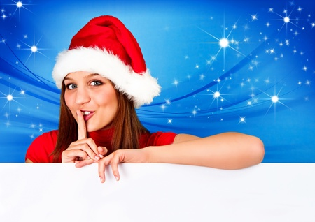 pretty santa girl holding a board photo