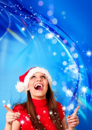 Santagirl with blue background and many flying stars photo