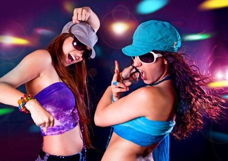 two hot girls dancing in the disco
