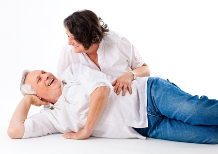 old man sitting: nice and happy couple lying on the floor Stock Photo