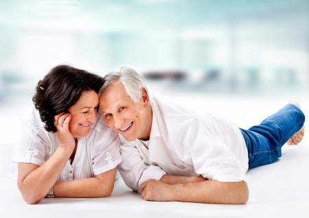 mature couple: attracitve senior couple having fun together