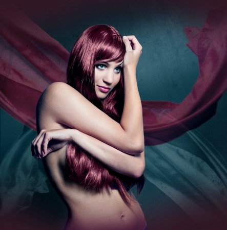 beautiful girl with red colored hair photo