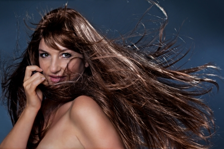 blowing wind: beautiful girl with long brown hair