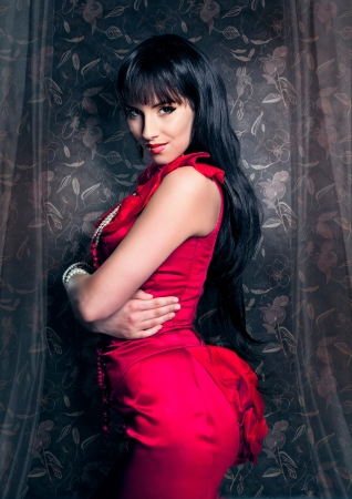 beautiful lady in red eveningdress Stock Photo - 15385398