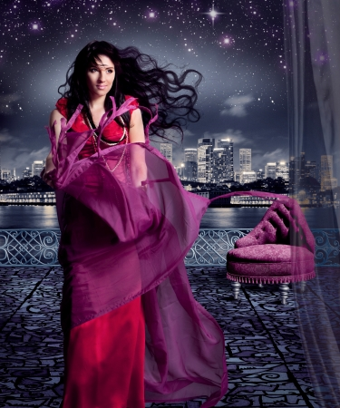 beautiful girl in evening dress on a terrace, like cinderella photo