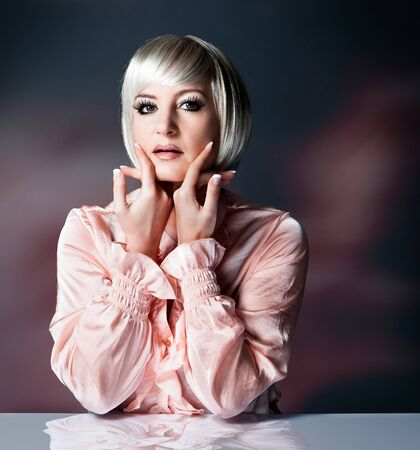 beautiful lady with blond bob holds her hands to the face Stock Photo - 15413305