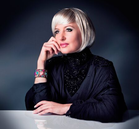Diva with black evening-robe photo