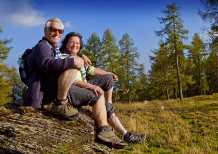 active woman: senior couple hiking in the nature Stock Photo