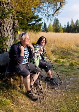 senior couple hiking in the nature photo