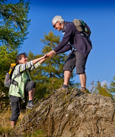 active holiday: senior couple hiking in the nature Stock Photo