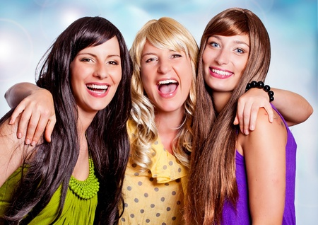 color skin brown: three girls with different haircolor laughing together