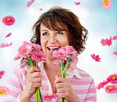 cheerful girl with a bouquet of pink flowers photo