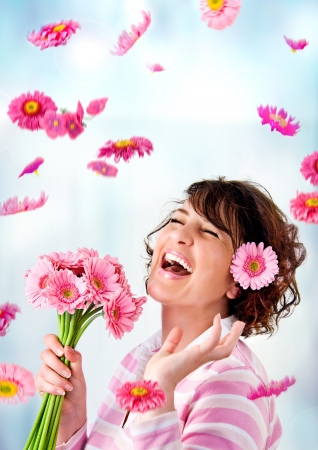 is raining: cheerful girl with a bouquet of pink flowers