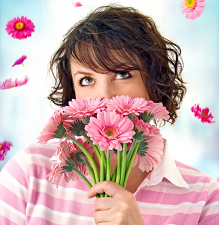 sassy: cheerful girl with a bouquet of pink flowers
