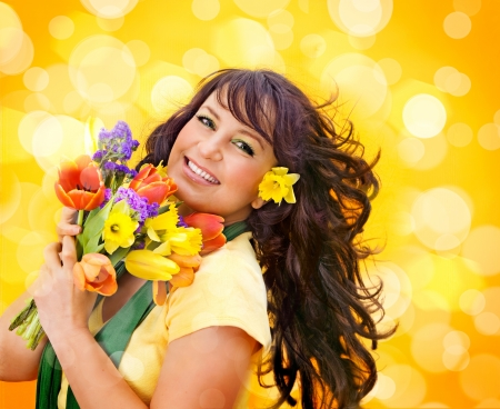cheerful girl with a bouquet of colorful flowers