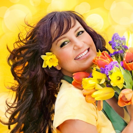 cheerful girl with a bouquet of colorful flowers photo