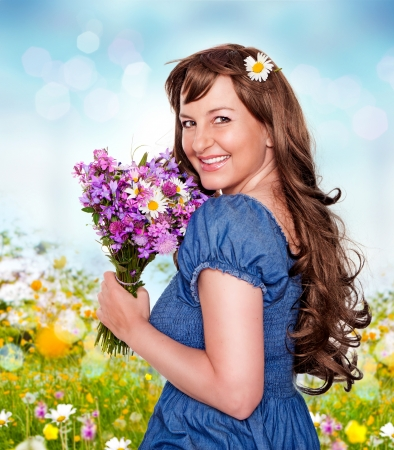 likable: girl with flowerbouquet in a meadow Stock Photo