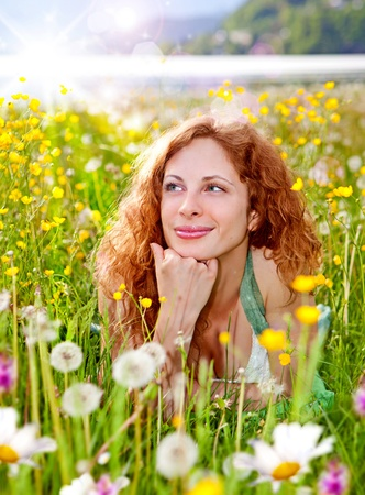 back lighting: sweet girl in a meadow full of dandelions Stock Photo
