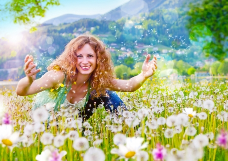 sassy: sweet girl in a meadow full of dandelions Stock Photo