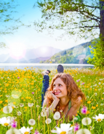 easygoing: sweet girl in a meadow full of dandelions Stock Photo