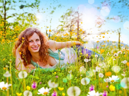 sweet girl in a meadow full of dandelions Stock Photo