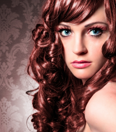 hair curl: portrait of beautiful lady with red curly hair