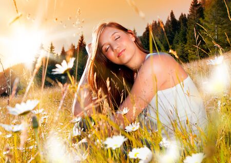 jaunty: girl in meadow full of flowers in the sunset