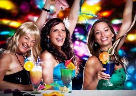 fete: three beautiful girls celebrating in a club Stock Photo