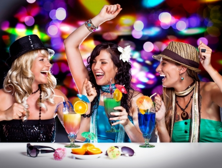 three beautiful girls celebrating in a club Stock Photo