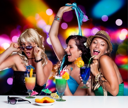 joking: three beautiful girls celebrating in a club Stock Photo