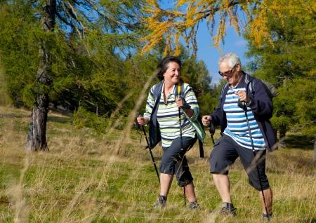 retirees: senior couple hiking in the nature Stock Photo