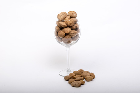 Almonds in the glass Imagens
