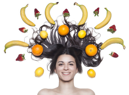 Nice woman whit lemon, strawberry, banana, orange photo