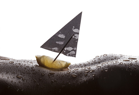Lemon boat sailing on wet woman body photo