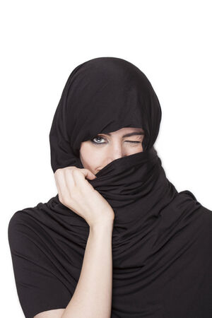 uncovering: Beautiful transgressive girl wearing a burqa and uncovering