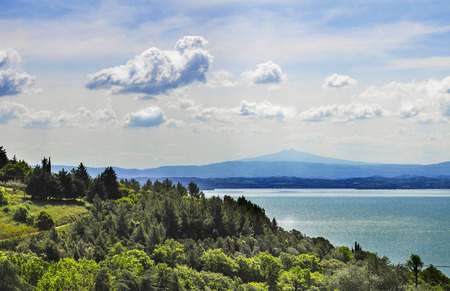 Italian landscape from Umbria with Trasimeno lake and clouds