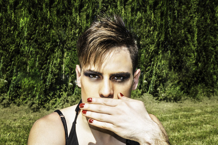 drag queen: Beautiful drag queen covering her mouth Stock Photo