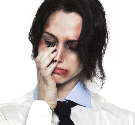 beaten up: Sad beaten up girl with wounds on the face crying