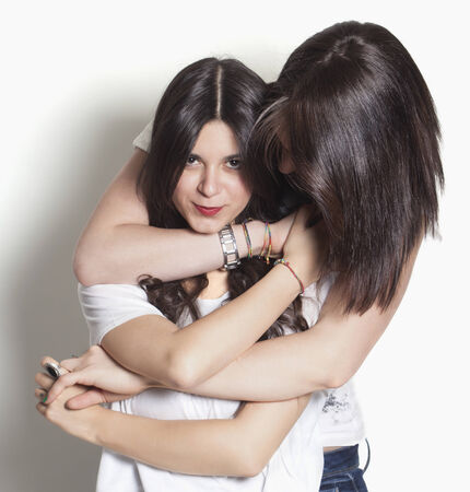lesbian relationship: Beautiful sisters smiling and hugging Stock Photo