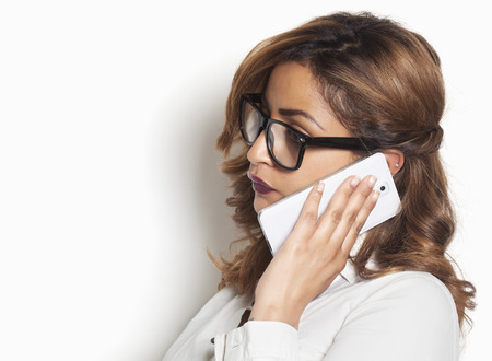 Beautiful businesswoman listening to a phone call