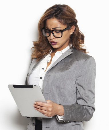 Beautiful disappointed businesswoman looking at the tablet