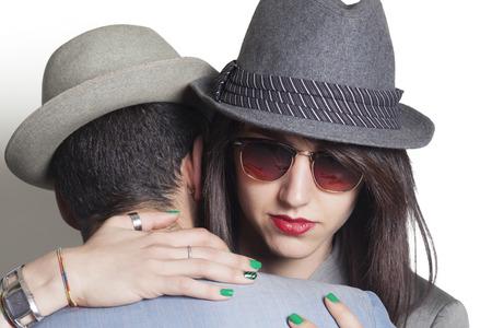 Beautiful gansgter couple hugging closeup